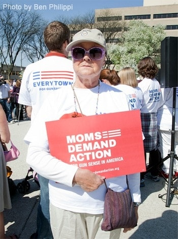 """An Everytown For Gun Safety protester attends Saturday's """"stroller jam"""" to end gun violence."""