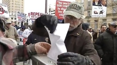 Protestors shred registration forms