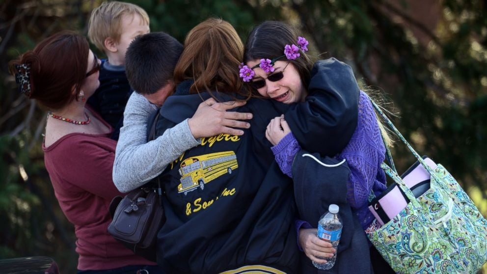 Parents and students embrace along School Road near Franklin Regional High School after a knife-wielding suspect at the school stabbed more than a dozen students on April 9, 2014, in Murrysville, Pa., near Pittsburgh. (Photo credit: Sean Stipp/Tribune Review/AP Photo)