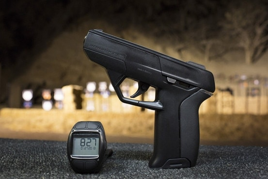 The Armatix iP1 uses an RFID-equipped watch paired to the handgun to electronically unlock the pistol. (Photo credit: Armatix)