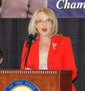 Gov. Jan Brewer scrapped two pro-gun bills Tuesday with the stroke of a pen when she did not agree with their contents. (Photo credit: Howard Fischer/Capitol Media Services)