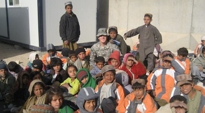 CPT Krug visiting an outdoor classroom for elementary school children in Kandahar Province, Afghanistan.  (Photo credit: Colby Krug)