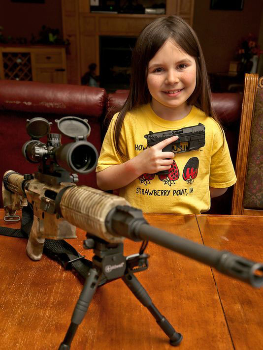 Eight-year-old Natalie Gibson cried as she walked out of the gun range after being asked to leave. According to her dad, Nathan, she thought she had done something wrong. (Photo credit: The Des Moines Register)
