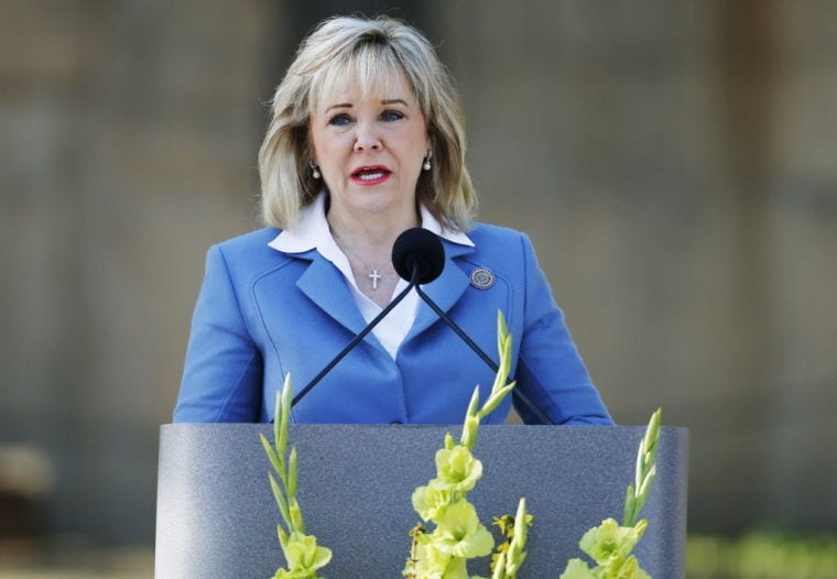 Gov. Mary Fallin, (R), vetoed 15 bills including one to speed up NFA processing through local law police chiefs. (Photo credit: Sue Ogrocki/AP)