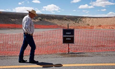 Cliven Bundy walks by a first amendment area set up by the Bureau of Land Management near Bunkerville, Nev. (AP)