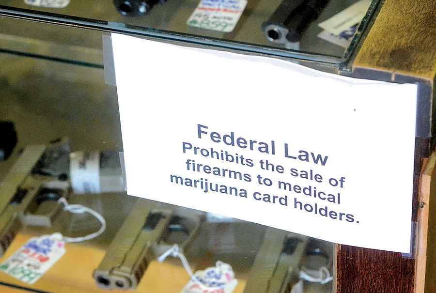 Although the state may change their tune on guns and cannabis, the federal government so far has not. (Photo credit: Pelleylawgroup.com)