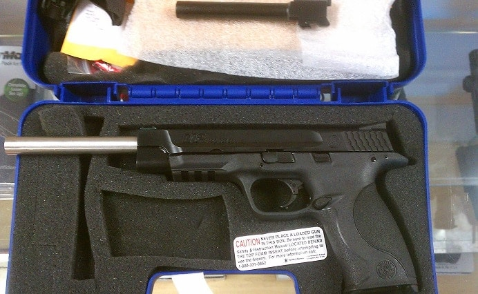 A Smith and Wesson M&P with a California-legal single shot kit installed, note the longer barrel length over the standard barrel shown above the top of the gun. (Photo credit: Calguns)