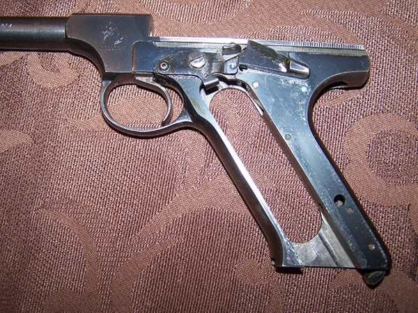 fieldstripped colt woodsman 22 pistol