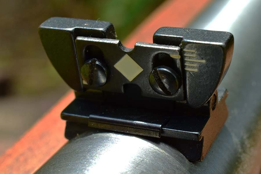 The original 10/22 iron sights are anything but user-friendly (Photo by Jim Grant)