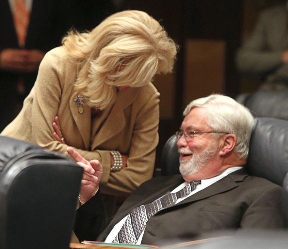 Sen. Maria Sachs, (D-Delray Beach), talks with Sen. Jack Latvala, (R-Clearwater), seated, on Thursday after the defeat of a controversial gun bill. (Photo credit: Scott Keeler/Tampa Bay Times)