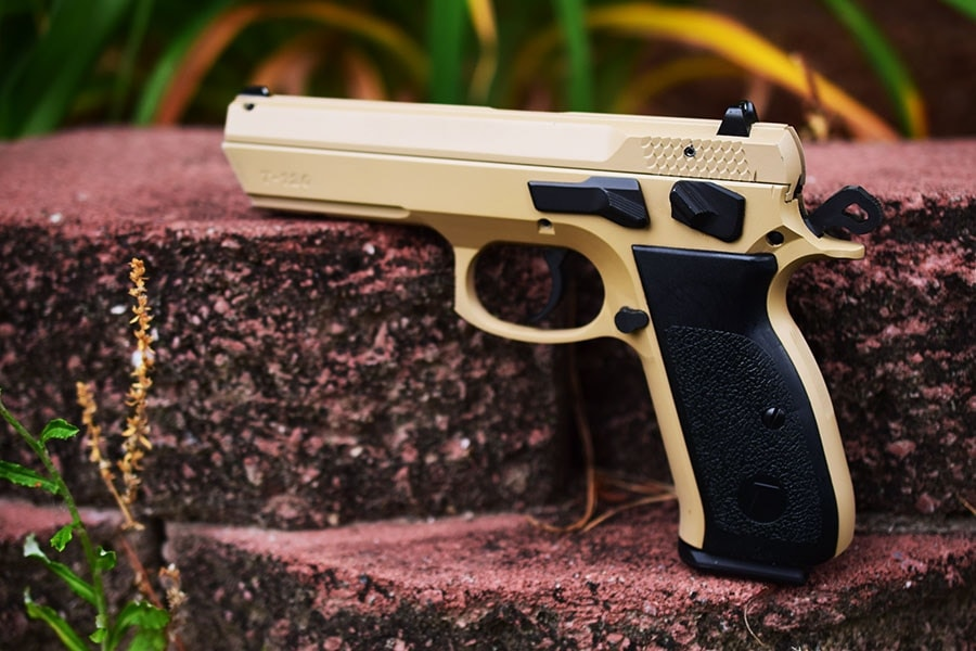 tristar t120 handgun sitting outside