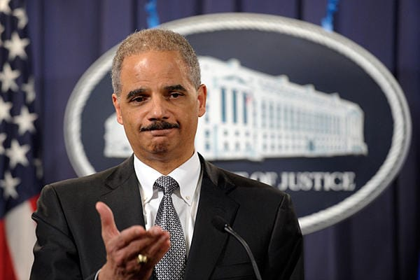 Attorney Gen. Eric Holder's Department of Justice, in coordination with the FDIC, is seeking to cut bank funding to high-risk businesses. (Photo credit: Susan Walsh/AP/File)