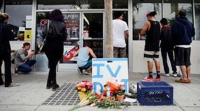 Some flowers are left in front of IV Deli Mart, where part of Friday night's mass shooting took place by a drive-by shooter, on Saturday, May 24, 2014, in Isla Vista, Calif. Alan Shifman, a lawyer who represents Hollywood director Peter Rodger, says the family believes Rodger's son, Elliot Rodger, was the lone gunman who went on the shooting rampage near the University of California at Santa Barbara. (Photo: Associated Press)
