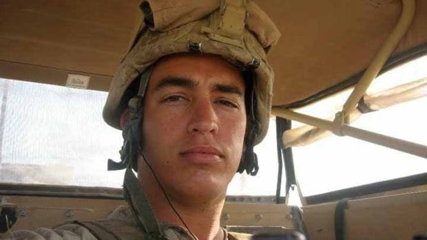 Sgt. Andrew Tahmooressi looks down from his seat in a Marine combat vehicle during one of his combat tours in Afghanistan 2010-2012. Tahmooressi is now in a Tijuana prison on weapons charges. (Family photo courtesy Jill Tahmooressi/MCT)