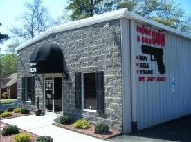 The store's old location has included similar signage for a decade. (Photo credit: Fuquay Gun and Gold)