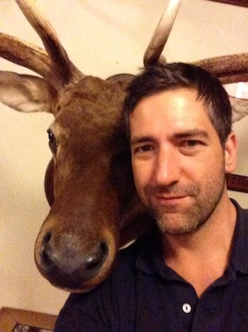 Mark Glaze, right, what appears to be a moose head, left.  (Photo credit: Facebook).