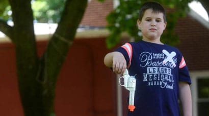 7-year-old Darin Simak faced expulsion after realizing that he had accidentally brought a toy cowboy gun, complete with an orange tip, to school. (Photo credit: Trib Live)