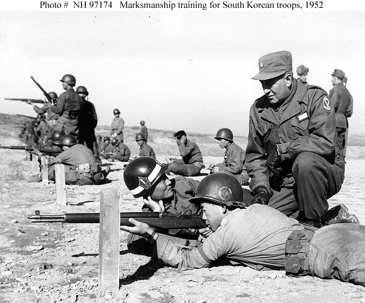 South Korean troops, seen here being trained by U.S. troops in 1952, on the M1 Garand. (Photo credit: U.S. Army)