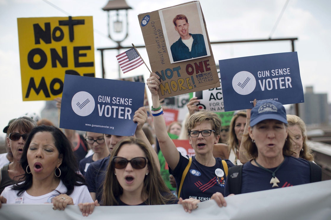 No hot dogs or soda pop here, but plenty of signs and angry women. (Photo credit: Associated Press)