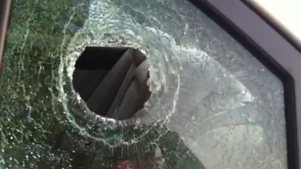Police say the victim's truck window was shot during the robbery attempt. (Photo credit: WAPT News)