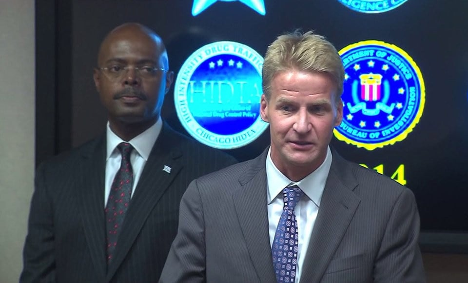 U.S. Attorney Zachary Fardon (right) and Chicago Police First Deputy Superintendent Alfonza Wysinger announce the creation of the Chicago Crime Gun Intelligence Center. (Photo credit: WGN-TV)