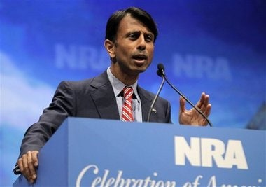 Gov. Bobby Jindal, shown speaking at the National Rifle Association convention, has just signed into law a pro-gun bill authorizing the use of suppressors for hunting. (Photo credit: Michael Conroy/AP)
