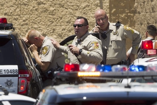 Police officers outside the North Nellis Blvd Wal-Mart after the shooting in Las Vegas on Sunday. (Photo credit: Steve Marcus/The Las Vegas Sun/Reuters)