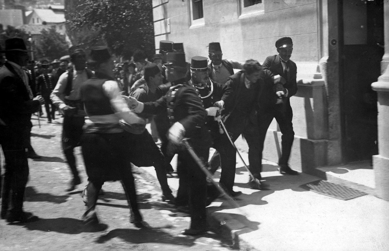 A Bosnian Serb nationalist (often credited as Gavrilo Princip), is captured by police and taken to the police station in Sarajevo, on June 28, 1914, following the assassination of Archduke Franz Ferdinand, heir to the Austrian-Hungarian throne, and his wife. (Photo credit: US National Archives)