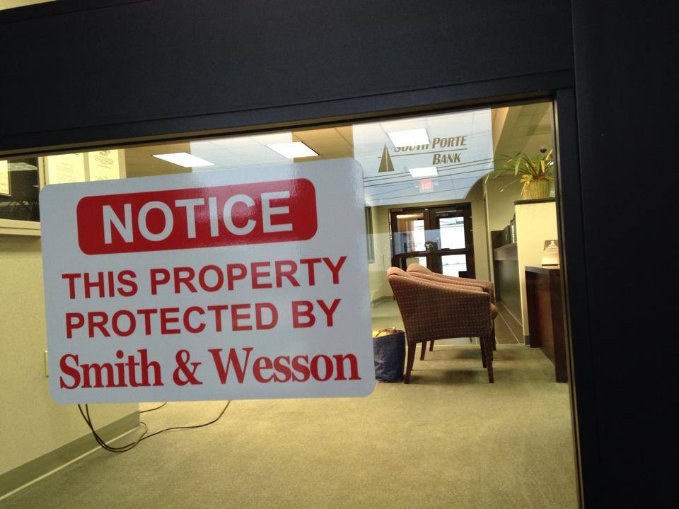 Signs at South Porte Bank advise that the institution is not a gun-free zone. (Photo credit: KFVS)