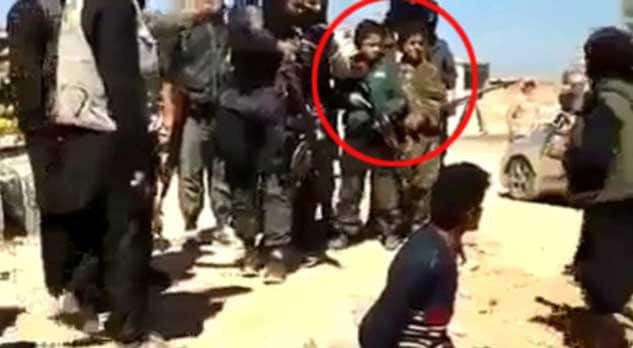 Iraqi children participating in roadside executions