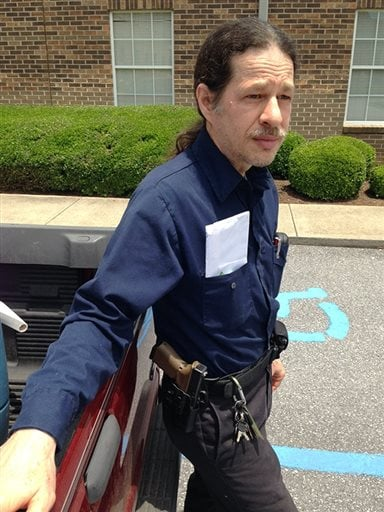 Gun rights activist John David Murphy outside his voting precinct with his firearm in Shelby County, Alabama. (Photo credit: Jay Reeves/AP)