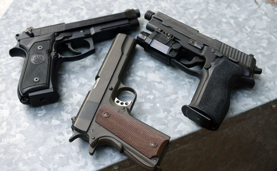 The M9, 1911 and the pistol I think should have replaced the 1911, the P226 (Photo by Jim Grant)