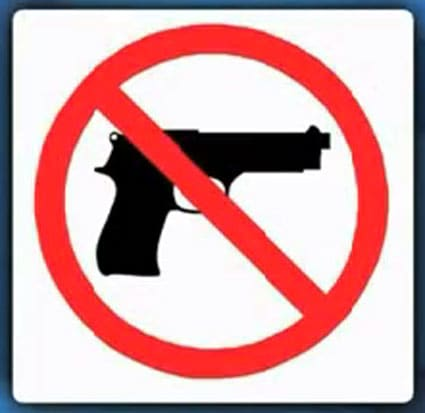 The man didn't see one of these on the door, so just assumed it was okay for him to carry his gun. Clearly, he was wrong. (Photo credit: KSN)
