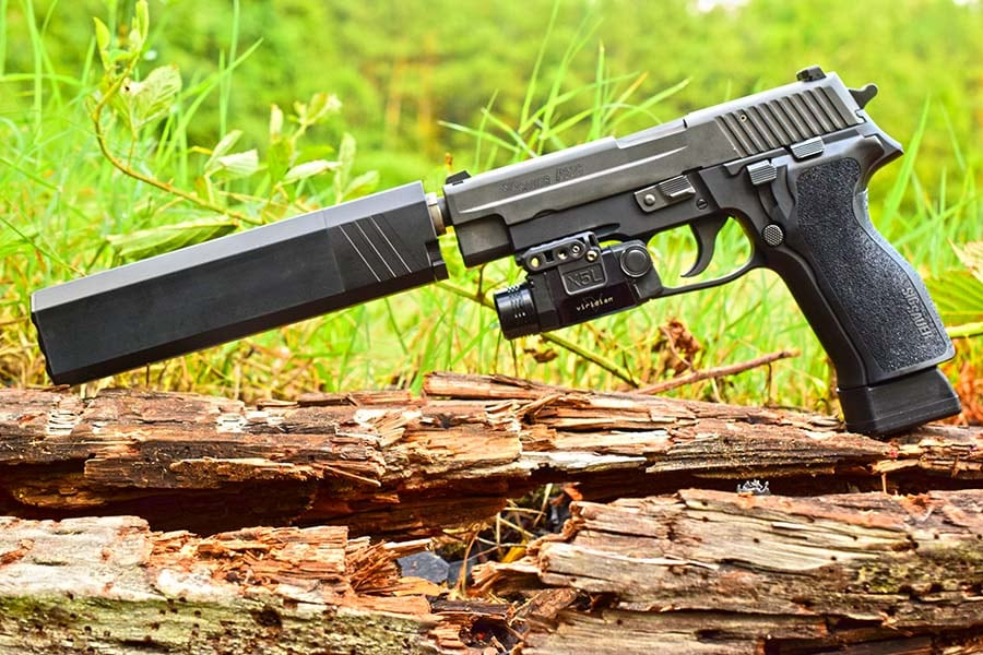 The X5L works equally as well on a stock handgun as this custom SIG P226 with Osprey sound suppressor. (Photo by Jim Grant)