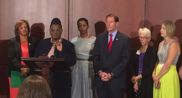 Sen. Richard Blumenthal (D-CT), joined by cosponsors as well as domestic violence survivors and their relatives, at a press conference introducing a new bill Tuesday aimed at taking guns from abusers. (Photo credit: Twitter https://twitter.com/RepGwenMoore/status/494205015243112448/photo/1 )