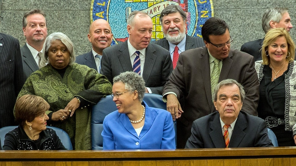 Commissioners and the Cook County Board President Toni Preckwinkle pose for a photo. (Photo credit: Zbigniew Bzdak/Chicago Tribune)