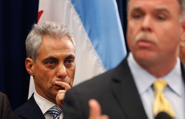 Rahm Emanuel, left, and Chicago's police superintendent at a news conference, December 2012. (AP Photo/Charles Rex Arbogast)