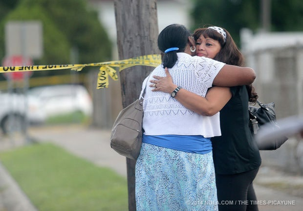 Family and church members comforted each other as police tape wrapped around the outside of the church. (Photo: Nola.com)