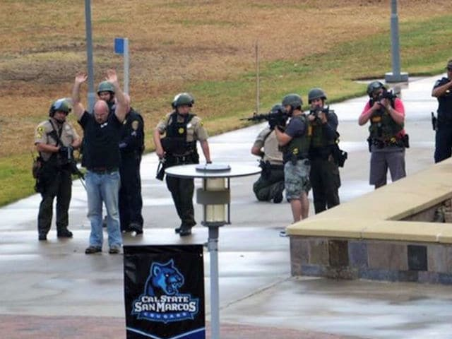 California State University San Marcos faculty member and umbrella owner Bill Craig surrendering to a police response team with an apparent cargo-short load out. (Photo: ABC 10)