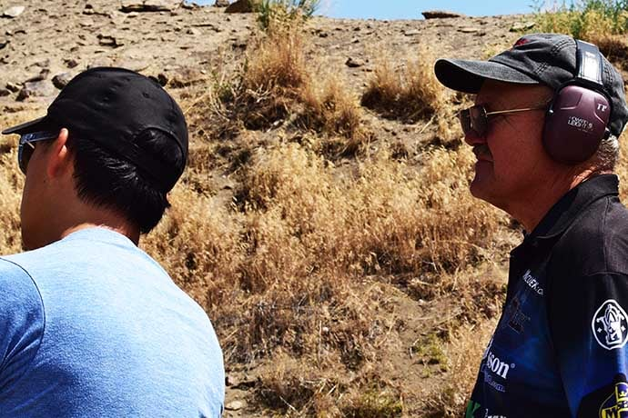 Jerrry Miculek giving pointers to Chris Cheng (Photo: Jim Grant)