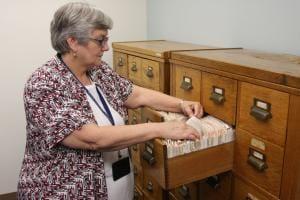 Cindy Buchanan with the Durham County Clerk of Superior Court, thumbs through gun registration paperwork housed in her office. (Photo: Dan Way/Carolina Journal)