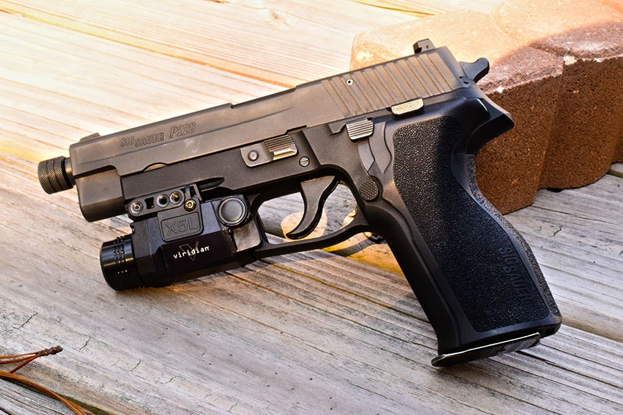 If you decide to go with a weapon-mounted light, the SIG P226 makes an ideal host and home-defense pistol. (Photo: Jim Grant)