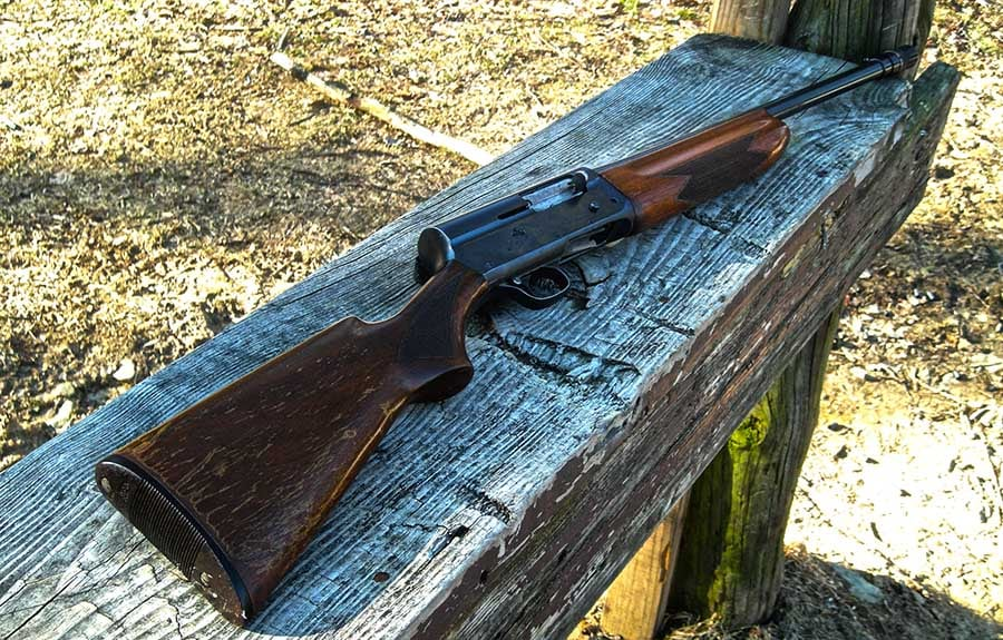 remington model 11 shotgun sitting on a wooded plank in a park