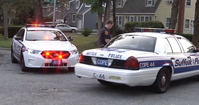 Neighbors told reporters that they didn't hear the gunshot, which came from inside the officer's home. (Photo: Newsday)