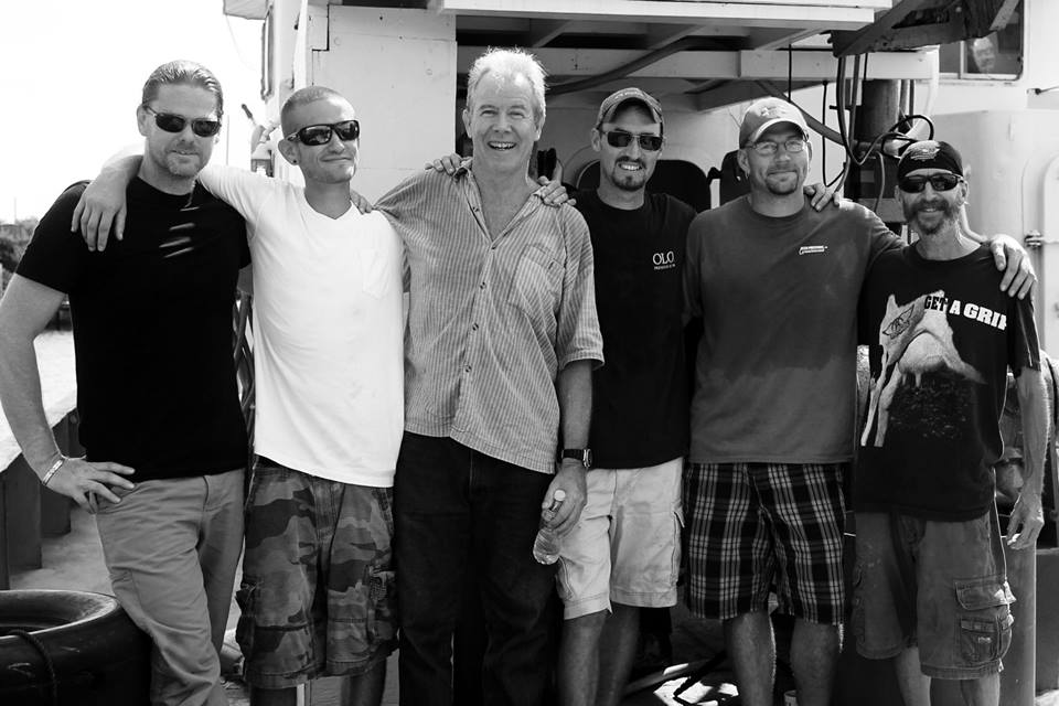 The Aquaquest Six after returning to the U.S. in July after spending 52 days in a Honduran jail on bogus gun charges. From left to right: Michael McCabe, Devon Butler, Robert H. Mayne Jr, Nick Cook, Steven Matanich, and Kelly Garrett. (Photo: Aquaquest International)