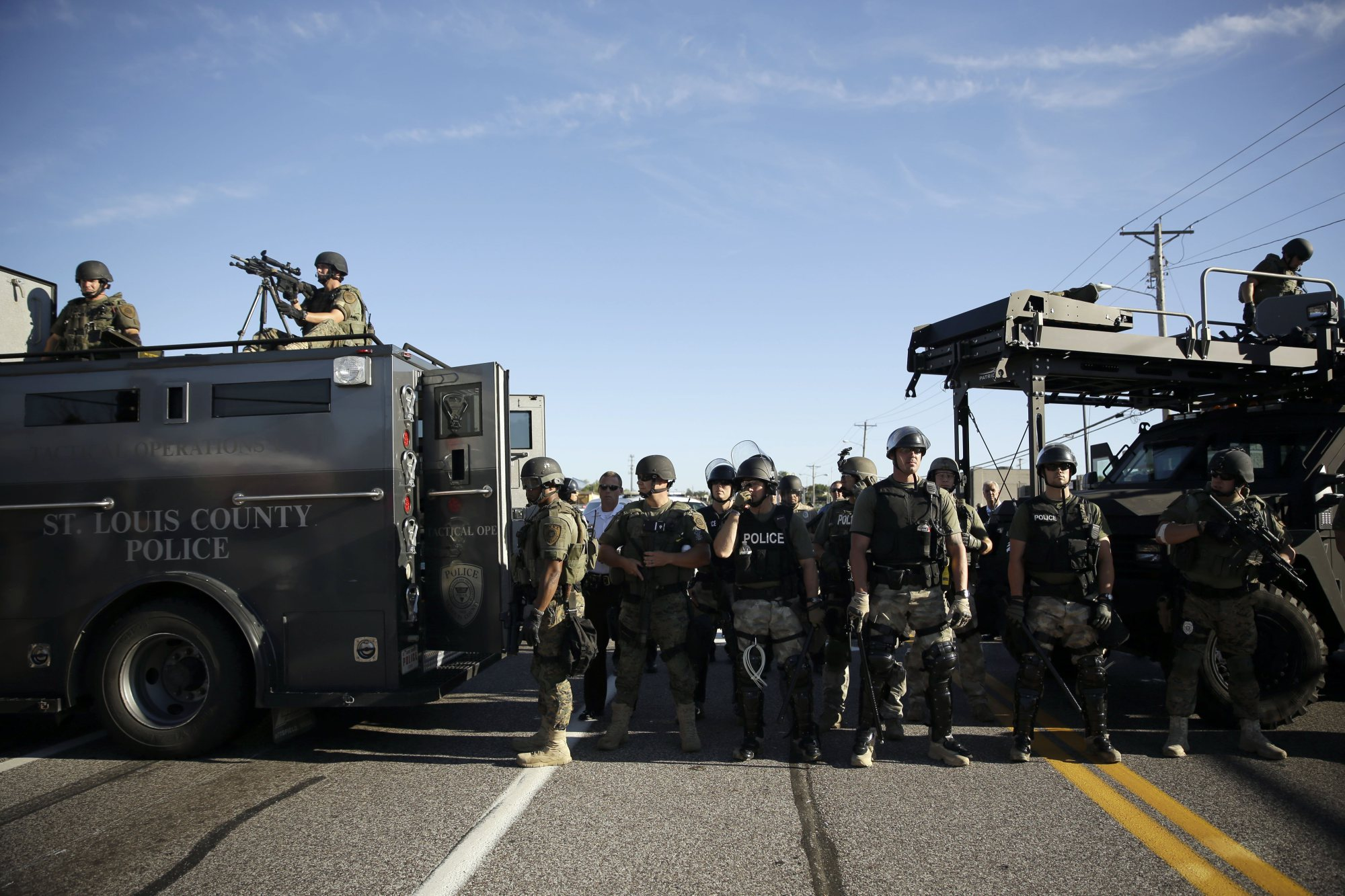 Police in riot gear watch protesters in Ferguson, Mo. on Aug. 13, 2014. (Photo: Jeff Roberson/AP)