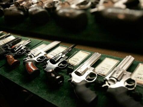 guns-in-display-case-reuters