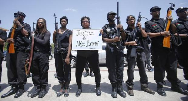 Some 30 members of the Huey P. Newton Gun Club marched through South Dallas in an open-carry rally Wednesday. (Photo: Vernon Bryant/Dallas Morning News)