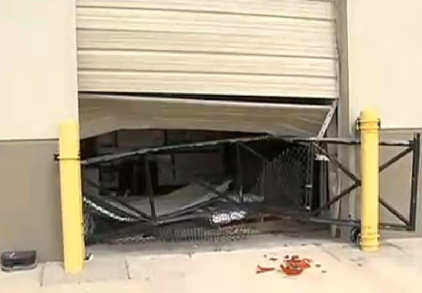 Burglars crashed through the rollup doors at a Houston Gander Mountain to grab 10 AR-15s Monday. (Photo: My Fox Houston)