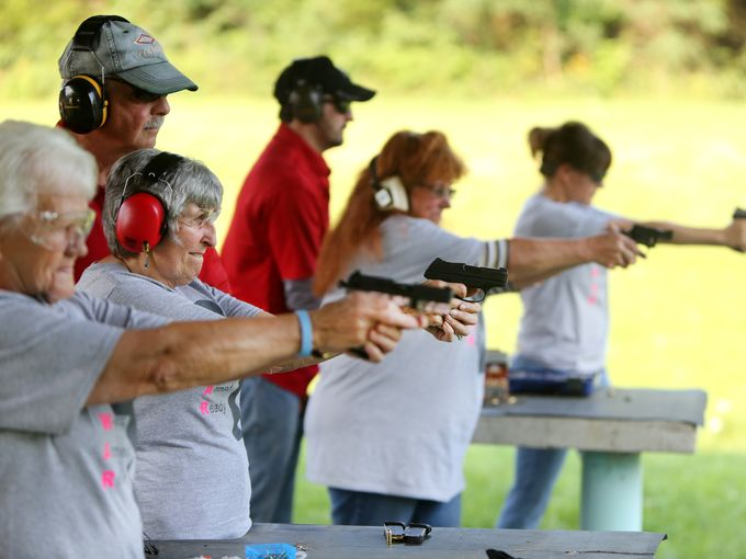 Members of the 'Women Armed and Ready' gun club take target practice at the Laughery Valley Fish and Game Shooting Range in Versailles. (Photo credit: Liz Dufour/The Cincinnati Enquirer)